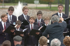 Members of the Boychoir of Ann Arbor singing at AATA headquarters