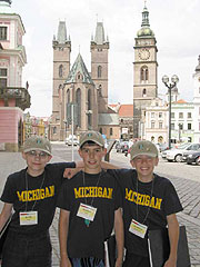 3 Choristers in front of cathedral in Hradec Kralove, Czech Republic