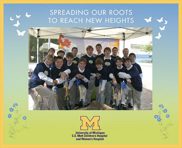 Cantabile poses with shovels and hard hats at Mott Groundbreaking